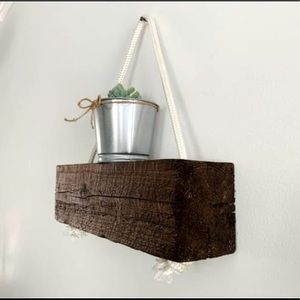 Shelf Made a Wooden Beam and a Rope
